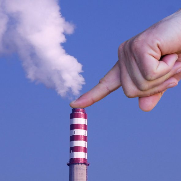 Man with hand making stop to environmental pollution